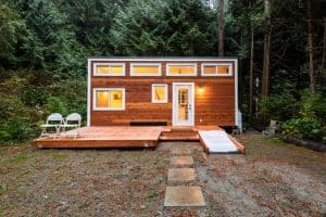 What should be considered before building or buying a tiny house