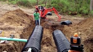 Excavate the hole for the tank and vent pipe according to the design